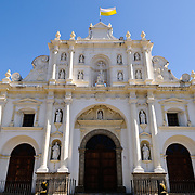 Th Catedral de Santiago on the main square of Antigua Guatemala. Famous for its well-preserved Spanish baroque architecture as well as a number of ruins from earthquakes, Antigua Guatemala is a UNESCO World Heritage Site and former capital of Guatemala.