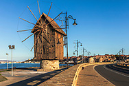 A wooden windmill before the town entrance