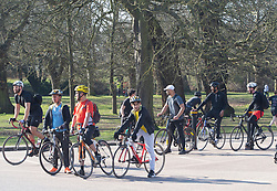 © Licensed to London News Pictures 27/02/2021.        Greenwich, UK. Cyclists in the park. People out and about during a third national Coronavirus lockdown enjoying the sunny weather in Greenwich Park, London. Photo credit:Grant Falvey/LNP