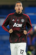 Manchester United Defender Chris Smalling warm up during the The FA Cup 5th round match between Chelsea and Manchester United at Stamford Bridge, London, England on 18 February 2019.