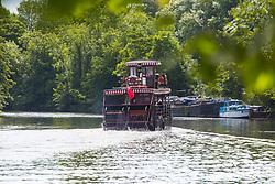 A padre steamer chugs its way along the River Thames at Old Windsor, Berkshire. Old Windsor, Berkshire, July 05 2019.