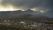 A massive hailstorm hits the Quinag mountains in Assynt, north west Scotland. Photography by Andrew Tobin/tobinators.com.