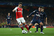 Mesut Ozil of Arsenal goes past Marco Verratti of Paris Saint-Germain. UEFA Champions league group A match, Arsenal v Paris Saint Germain at the Emirates Stadium in London on Wednesday 23rd November 2016.<br /> pic by John Patrick Fletcher, Andrew Orchard sports photography.