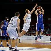 Anadolu Efes's Thomas Heurtel (R) and Nizhny Novgorod's Dimitriy Khvostov (2ndR) during their Turkish Airlines Euroleague Basketball Top 16 Round 11 match Anadolu Efes between Nizhny Novgorod at Abdi ipekci arena in Istanbul, Turkey, Thursday March 19, 2015. Photo by Aykut AKICI/TURKPIX