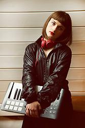 Portrait of Teenage Holding Synthesizer