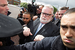 © Licensed to London News Pictures . 07/05/2014 . Leeds , UK . PAUL FLOWERS leaves Leeds Magistrates Court this morning (7th May 2014) . The former Co-operative Bank chairman was charged with two counts of possession of Class A drugs - cocaine and methamphetamine - and one count of possession of the Class C drug , ketamine . He is currently suspended from his position as a Methodist Minister and also from the Labour Party . Also charged is relation to Flowers is Gavin Woroniuk , 33 , of Mitford Road, Leeds, who faces four counts of offering to supply controlled drugs and one count of possession of criminal property . Photo credit : Joel Goodman/LNP