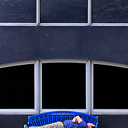 Zach Harris lounges on a bench during his lunch break in downtown Toledo on Monday, June 12, 2017. THE BLADE/KURT STEISS