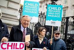 © Licensed to London News Pictures. 05/11/2018. London, UK. Lord Alf Dubs (left) joins activists to deliver a petition to Downing Street calling on the Prime Minister to commit to giving 10,000 refugee children safe passage to the UK over 10 years. Photo credit : Tom Nicholson/LNP