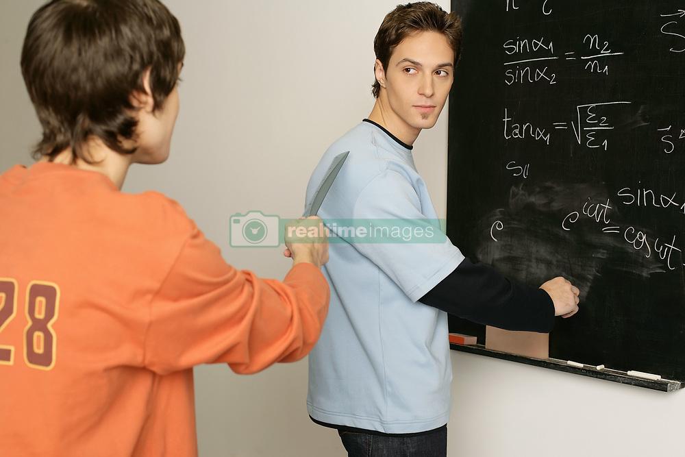 Dec. 15, 2012 - Two students in a classroom (Credit Image: © Image Source/ZUMAPRESS.com)