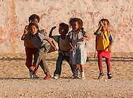 Children end a school day on December 17, 2003, in the Saharawi refugee camps. Saharawi people have been living at the refugee camps of the Algerian desert named Hamada, or desert of the deserts, for more than 30 years now. Saharawi people have suffered the consecuences of European colonialism and the war against occupation by Moroccan forces. Polisario and Moroccan Army are in conflict since 1975 when Hassan II, Moroccan King in 1975, sent more than 250.000 civilians and soldiers to colonize the Western Sahara when Spain left the country. Since 1991 they are in a peace process without any outcome so far. (Ander Gillenea / Bostok Photo)