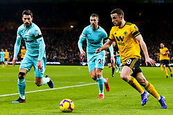 Joao Moutinho of Wolverhampton Wanderers takes on Fabian Schar of Newcastle United - Mandatory by-line: Robbie Stephenson/JMP - 11/02/2019 - FOOTBALL - Molineux - Wolverhampton, England - Wolverhampton Wanderers v Newcastle United - Premier League