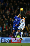 Joe Bennett of Cardiff City (l) jumps for a header with Fiyako Tomori of Hull city. EFL Skybet championship match, Cardiff city v Hull city at the Cardiff city stadium in Cardiff, South Wales on Saturday 16th December 2017.<br /> pic by Andrew Orchard, Andrew Orchard sports photography.