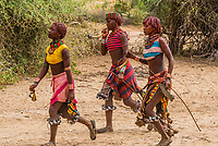 Hamer tribe women at a bull jumping ceremony, which is a rite of passage to initiate a boy into manhood. Omo Valley, Ethiopia.