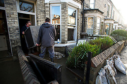 © Licensed to London News Pictures. 29/12/2015. York, UK. A sofa being lifted from a flood damaged property on Huntingdon Road in central York on December 29, 2015. Further rainfall is expected over coming days as Storm Frank approaches the east coast of the country. Photo credit: Ben Cawthra/LNP
