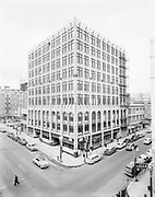 Simon 046. Eastern Outfitting Co. building, SW 10th & Washington, from fire escape of 4th floor Pittock Place. Blue Mouse Theatre on right. March 27, 1956