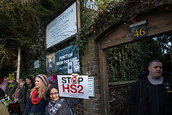 Uxbridge, UK. 1 February, 2020. Environmental activists from Stop HS2, Save the Colne Valley and Extinction Rebellion campaigning against the controversial HS2 high-speed rail link protest outside the Conservative Club in Uxbridge during a 'Still Standing for the Trees' march from the Harvil Road wildlife protection camp in Harefield through Denham Country Park to three addresses closely linked to Boris Johnson in his Uxbridge constituency. The Prime Minister is expected to make a decision imminently as to whether to proceed with the high-speed rail line.