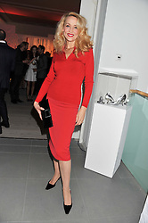 JERRY HALL at a party hosted by Ines de la Frassange and Bruno Frisoni for Roger Vivier to launch the Roger Vivier book held at The Saatchi Gallery, London on 24th April 2013.