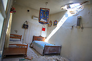 General picture shows a devastated bedroom in Anadan, along with the rest of what resembles a ghost town on Monday, June 25, 2012. It bears the scars from Syrian President Bashar al-Assad's use of military force to crush an opposition movement that has spawned an armed insurgency against his rule. (Photo by Vudi Xhymshiti)