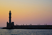 Lighthouse in the old, Venetian harbour at Chania, Crete, Greece at sunset