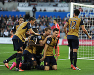 Laurent Koscielny of Arsenal © celebrates with teammates after he scores his teams 2nd goal. Barclays Premier league match, Swansea city v Arsenal  at the Liberty Stadium in Swansea, South Wales  on Saturday 31st October 2015.<br /> pic by  Andrew Orchard, Andrew Orchard sports photography.