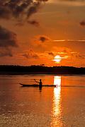 A lone kayaker silhouetted by sunrise at Isle of Palms beach at Wild Dunes near Charleston, South Carolina.