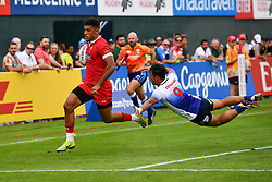 Rio Dyer of Wales  evades the tackle of Taichi Yoshizawa of Japan to score a try<br /> <br /> Photographer Craig Thomas/Replay Images<br /> <br /> World Rugby HSBC World Sevens Series - Day 3 - Saturday 7rd December 2019 - Sevens Stadium - Dubai<br /> <br /> World Copyright © Replay Images . All rights reserved. info@replayimages.co.uk - http://replayimages.co.uk