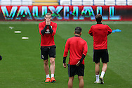 Gareth Bale of Wales (L) reacts during the Wales football team training at the Cardiff city Stadium in Cardiff , South Wales on Saturday 8th October 2016, the team are preparing for their FIFA World Cup qualifier home to Georgia tomorrow. pic by Andrew Orchard, Andrew Orchard sports photography