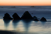 Rock formations and surf, winter sunset, Garapatta State Beach, Big Sur, California