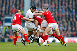 England Number 8 Billy Vunipola is tackled by Wales Prop Rob Evans and Prop Samson Lee - Mandatory byline: Rogan Thomson/JMP - 12/03/2016 - RUGBY UNION - Twickenham Stadium - London, England - England v Wales - RBS 6 Nations 2016.