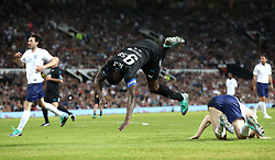 World XI's Usain Bolt falls to the floor during the UNICEF Soccer Aid match at Old Trafford, Manchester.