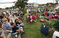 Spectators crowd the lawn at the end of Main Street in Titusville, FL, USA, on Wednesday, May 27, 2020. The crowd was awaiting the SpaceX and NASA rocket launch of two astronauts from the nearby Kennedy Space Center, which was postponed due to weather. Photo by Stephen M. Dowell/Orlando Sentinel/TNS/ABACAPRESS.COM
