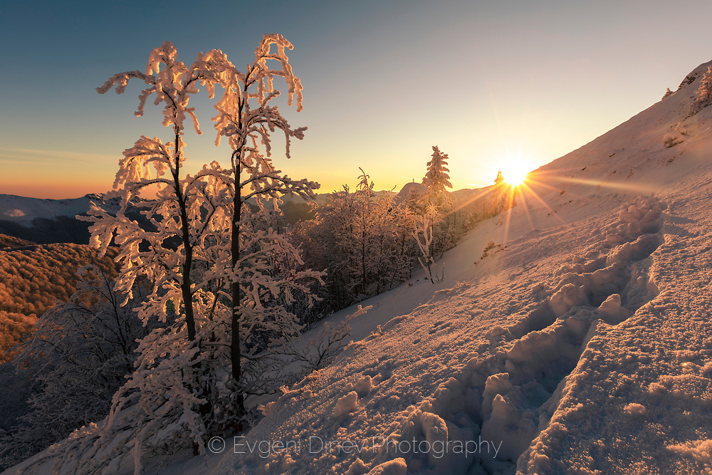 Sunny morning in the mountain at winter time