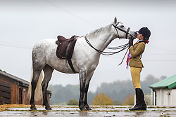 © Licensed to London News Pictures. 18/10/2015. Harrogate. 14 year old Marianna Stephenson from Cumbria kisses her horse on the nose after the pair won the Home Produced Best Rider & Horse Championship & the Working Hunter Pony Championship at The 13th annual Countryside Live event at Harrogate show ground in Yorkshire. Photo credit: Andrew McCaren/LNP