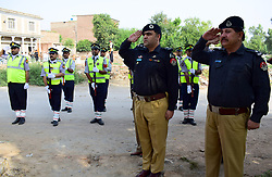 August 4, 2017 - Pakistan - PESHSHAWAR, PAKISTAN, AUG 04: SSP Traffic Police, Yasir Afridi and other officers are .paying homage to martyred police staffs at monument on the occasion of Police Day in Peshawar .on Friday, August 04, 2017. (Credit Image: © PPI via ZUMA Wire)