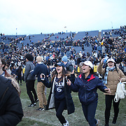NEW HAVEN, CONNECTICUT - NOVEMBER 18: Yale fans celebrate victory after the Yale V Harvard, Ivy League Football match at the Yale Bowl. Yale won the game 24-3 to win their first outright league title since 1980. The game was the 134th meeting between Harvard and Yale, a historic rivalry that dates back to 1875. New Haven, Connecticut. 18th November 2017. (Photo by Tim Clayton/Corbis via Getty Images)