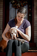 SHOT 2/21/17 2:21:01 PM - Tanner, a 12 year-old male Vizsla, with his mom Margaret Ebeling in Denver, Co. The Vizsla, is a dog breed originating in Hungary. The Hungarian or Magyar Vizsla represents one of the best in sporting dogs and loyal companions and has a strong claim to being one of the smallest of the all-round pointer-retriever breeds. The Vizsla's size is one of the breed's most attractive characteristics and through the centuries he has held a unique position for a sporting dog -- that of household companion and family dog. The Vizsla is a natural hunter endowed with a good nose and an above average trainability. Although they are lively, gentle mannered, demonstrably affectionate and sensitive, they are also fearless and possessed of a well-developed protective instinct.<br /> (Photo by Marc Piscotty / © 2017)
