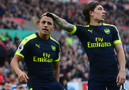 Alexis Sanchez of Arsenal (l) celebrates after he scores his teams 3rd goal. Premier league match, Stoke City v Arsenal at the Bet365 Stadium in Stoke on Trent, Staffs on Saturday 13th May 2017.<br /> pic by Bradley Collyer, Andrew Orchard sports photography.