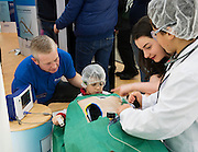 27/11/2016 REPRO FREE:   <br /> Quentin Gargan & Maeve Britton, Medtronic with  Cillian Urroz (9) & Lucas O'Connell (8) from Galway enjoy the Medtronic Exhibition inNUI Galway as part of the Galway Science & Technology Festival.Photo: Andrew Downes, Xposure.