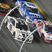NASCAR Sprint Cup driver Jimmie Johnson (48)  and Kevin Harvick (29) race for the lead during the NASCAR Coke Zero 400 Sprint series auto race at the Daytona International Speedway on Saturday, July 6, 2013 in Daytona Beach, Florida.  (AP Photo/Alex Menendez)
