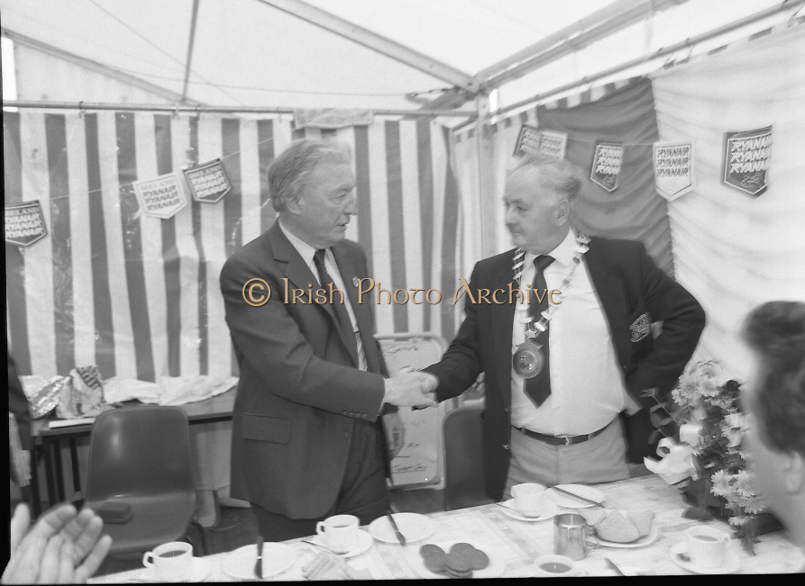 Charles Haughey Visits The Community Games. (T5)..1989..03.10.1989..10.03.1989..3rd September 1989..An Taoiseach, Charles Haughey TD,accompanied by Mr Frank Fahey, TD, Minister of State with responsibility for Youth and Sport attended the Twentieth National Finals of the Community Games at Mosney,  Co.Meath yesterday...Stopping for a well earned cup of tea An Taoiseach is met by the chairman of the games organising committee. Sorry we do not have a caption sheet if you know him why not let know at irishphotoarchive@gmail.com