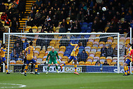 Mansfield Town defender Krystian Pearce (5) heads the ball  during the EFL Sky Bet League 2 match between Mansfield Town and Grimsby Town FC at the One Call Stadium, Mansfield, England on 4 January 2020.