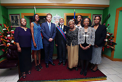 Prince Harry presents Sir Edmund Lawrence with his GCMG during a reception hosted by Governor-General of Saint Kitts and Nevis Sir Tapley Seaton at Government House, Basseterre, during the second leg of his Caribbean tour.