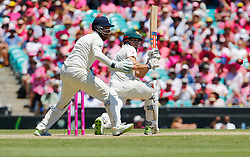 Australia's Shaun Marsh plays a shot as Jonny Bairstow looks on during day two of the Ashes Test match at Sydney Cricket Ground.