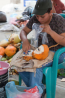 Preparing produce for sale at the San Ignacio market in Belize.