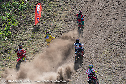 High energy as multiple riders race up the hill at the same time at the Gunstock Hillclimbs during Laconia Motorcycle Week. NH. USA. Wednesday June 13, 2018. Photography ©2018 Michael Lichter.