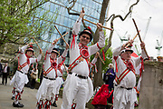 Morris Men dance on St Georges Day in the gardens of St Botolphs without Bishopsgate church in the capitals financial district aka The Square Mile, on 23rd April, City of London, England.