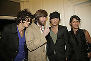 Dirty Pretty Things inc. Carl Barat  ( in cap ) and Lisa Moorish. PPQ of Mayfair shop launch. 47 Conduit St. 18 September 2006. ONE TIME USE ONLY - DO NOT ARCHIVE  © Copyright Photograph by Dafydd Jones 66 Stockwell Park Rd. London SW9 0DA Tel 020 7733 0108 www.dafjones.com