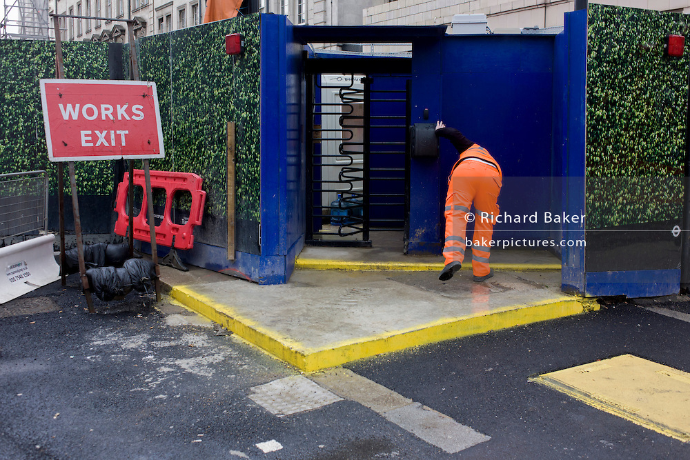 Construction worker and temporary works site landscape in Paddington, central London.