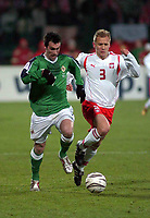 Photo. PIOTR HAWALEJ/Digitalsport<br /> Poland v Northern Ireland<br /> 30/03/2005<br /> 2006 World Cup Qualifier<br /> Poland's Tomasz Rzasa /3/ and Northern Ireland's  Keith Gillespie /7/battle for the ball