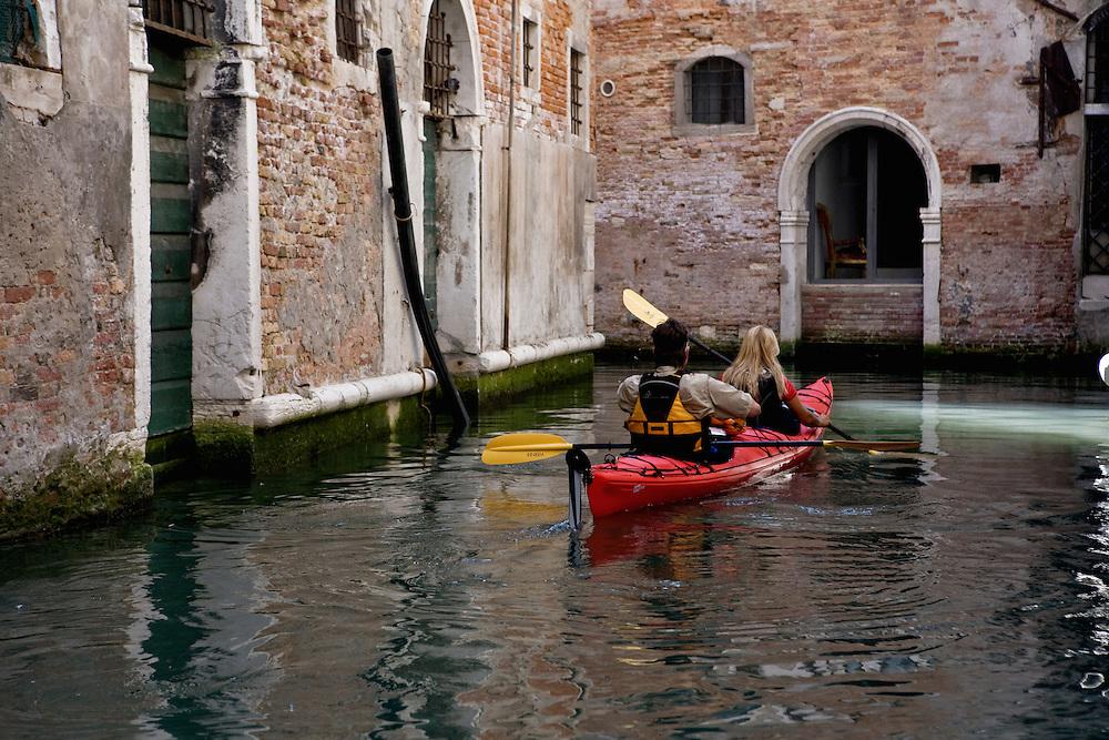Couple Exploring Venice with a canoe
